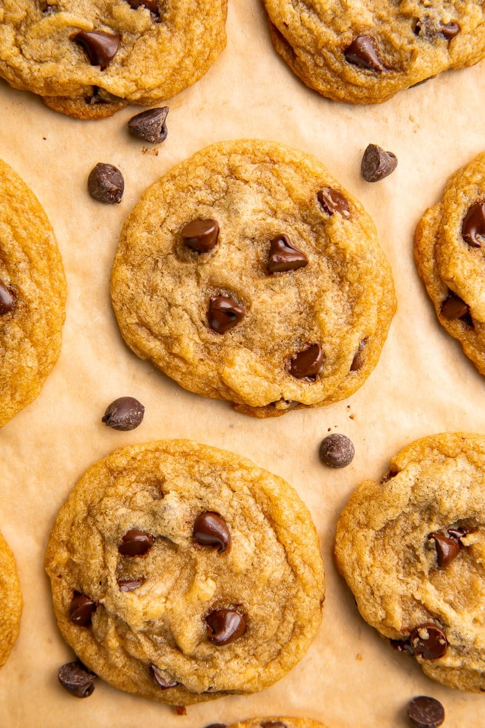 7 vegan chocolate chip cookies on parchment paper