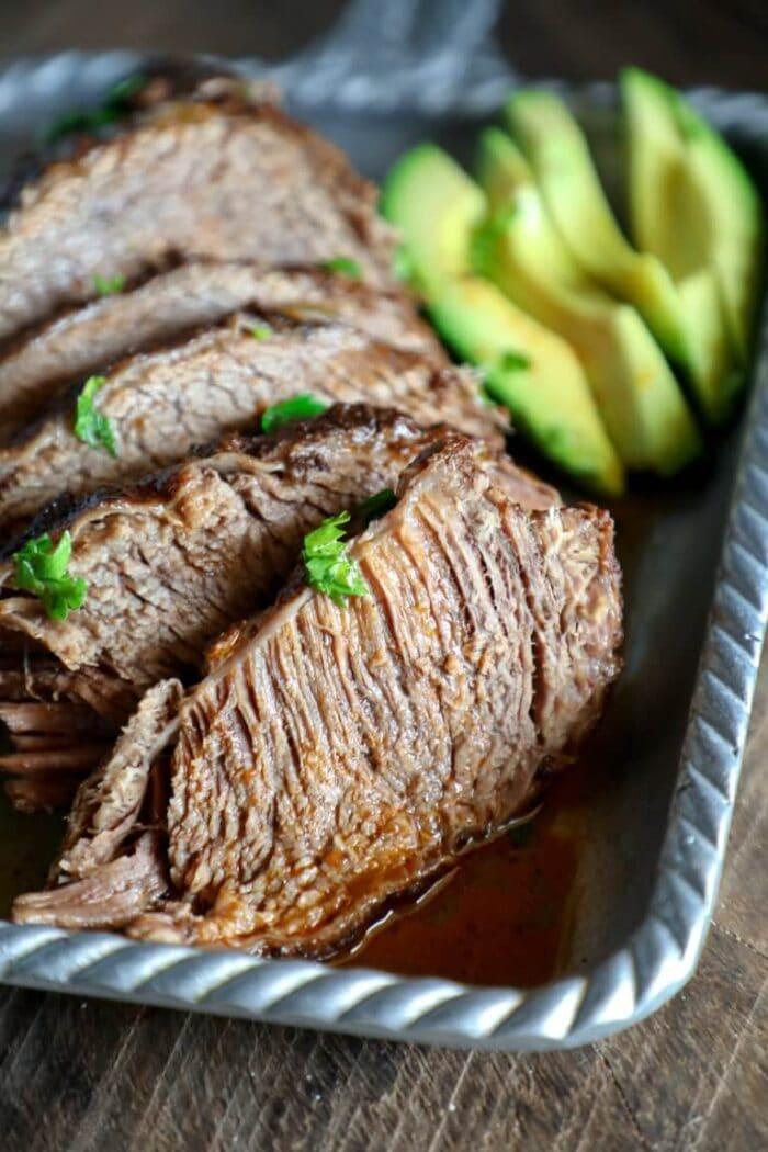 Close up of beef brisket on a metal pan