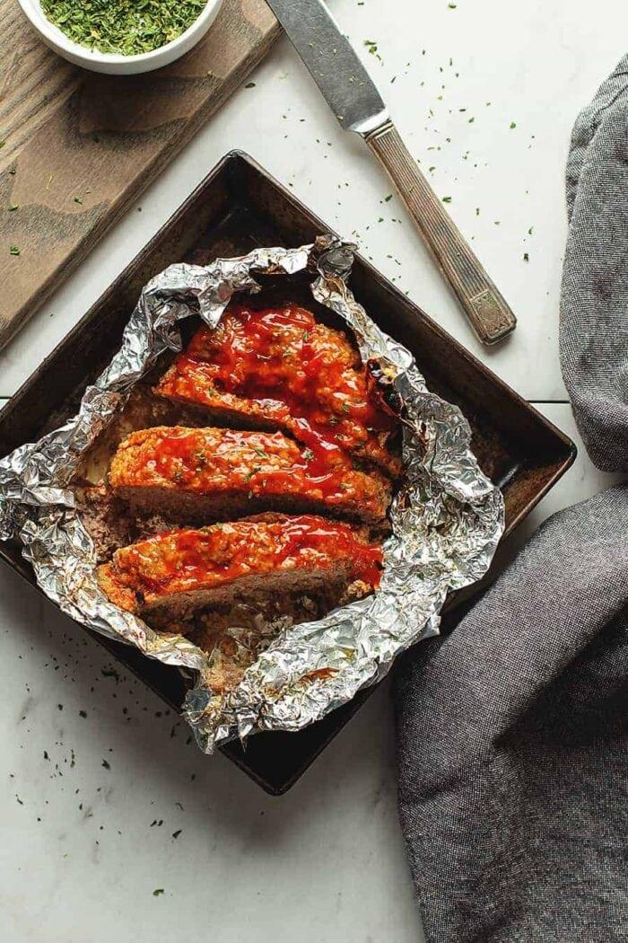 3 slices of meatloaf on aluminum foil