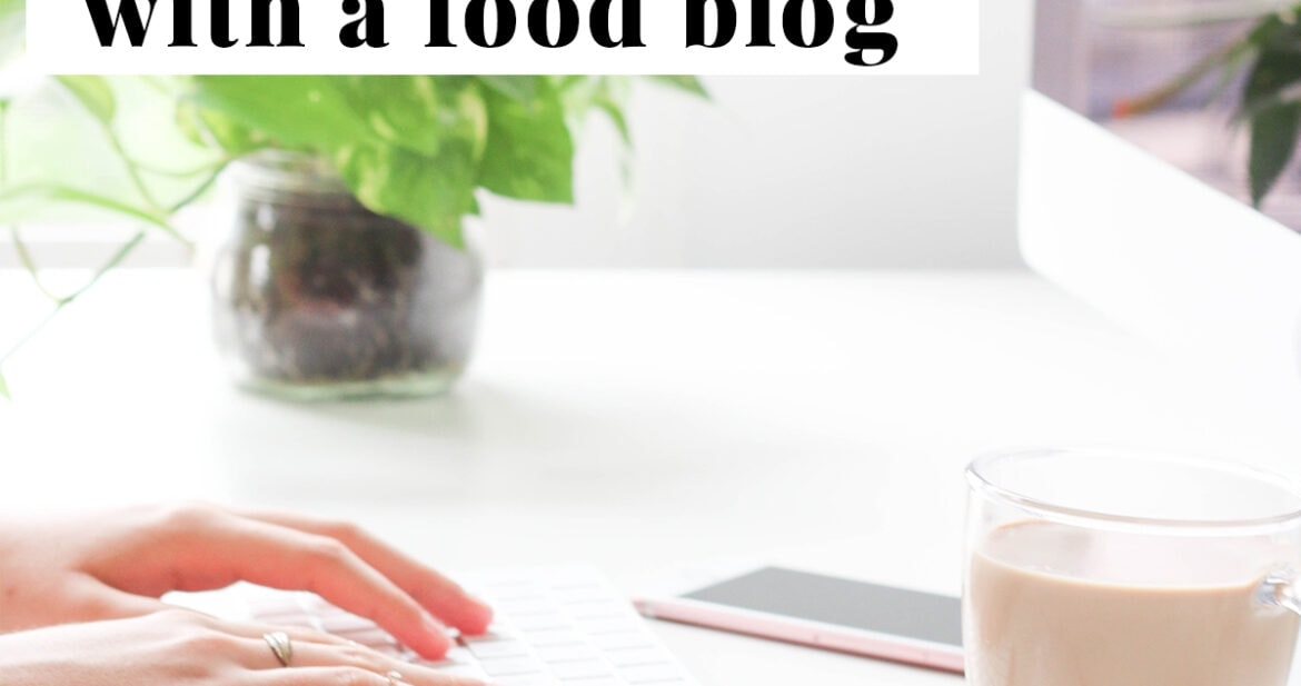 Graphic for how to make money with a food blog. A pair of hands typing on a white iMac keyboard, with a white Apple mouse, a clear glass mug of coffee, and the corner of an iMac in the frame.