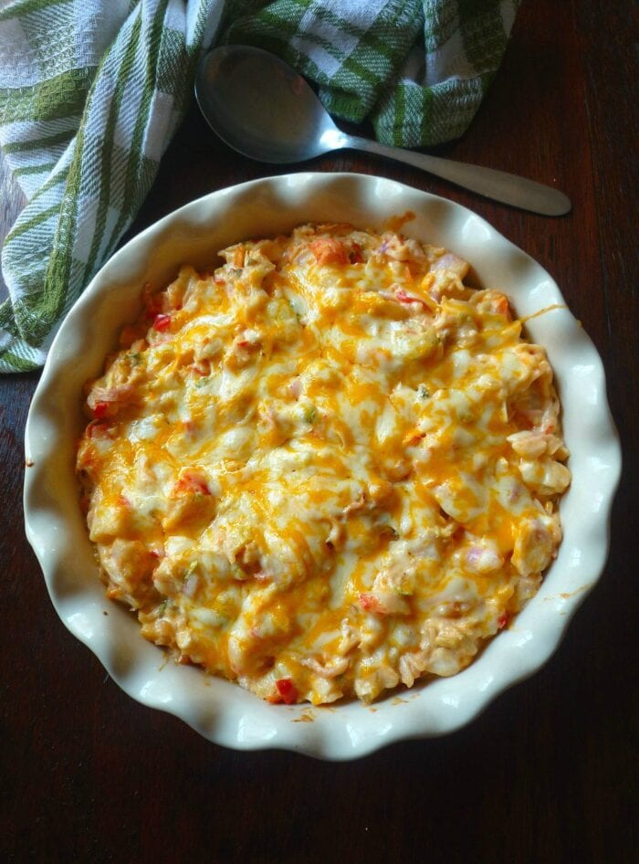 Cheesy crab casserole in a scallop-edge white casserole dish