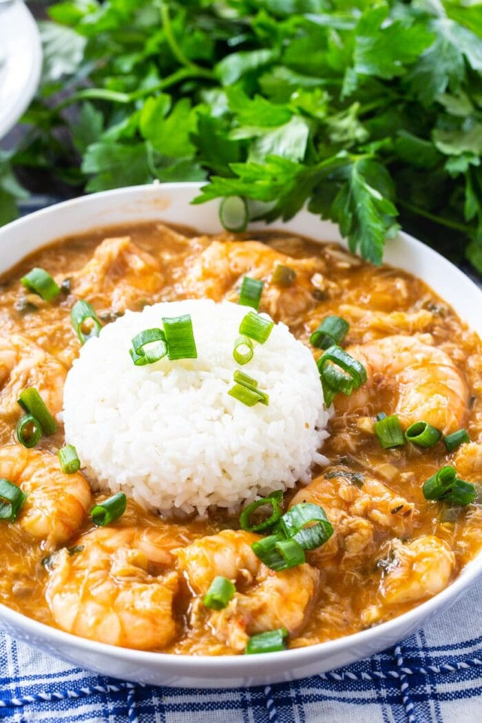Crab and shrimp etouffee with white rice and green parsley