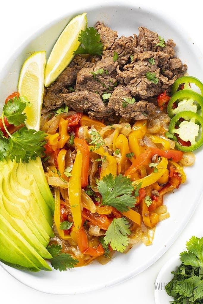 Instant pot steak fajita tray with steak, peppers, and avocado