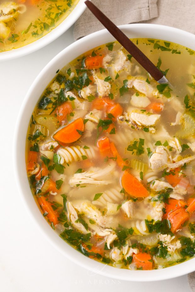 Gluten free chicken noodle soup in a white bowl
