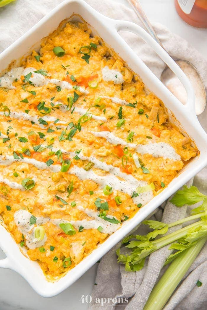 Paleo buffalo chicken casserole in a square pan turned at an angle