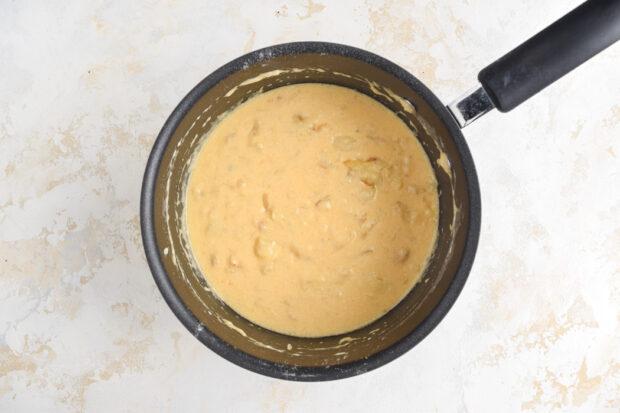 Cheesy onion sauce in a saucepan