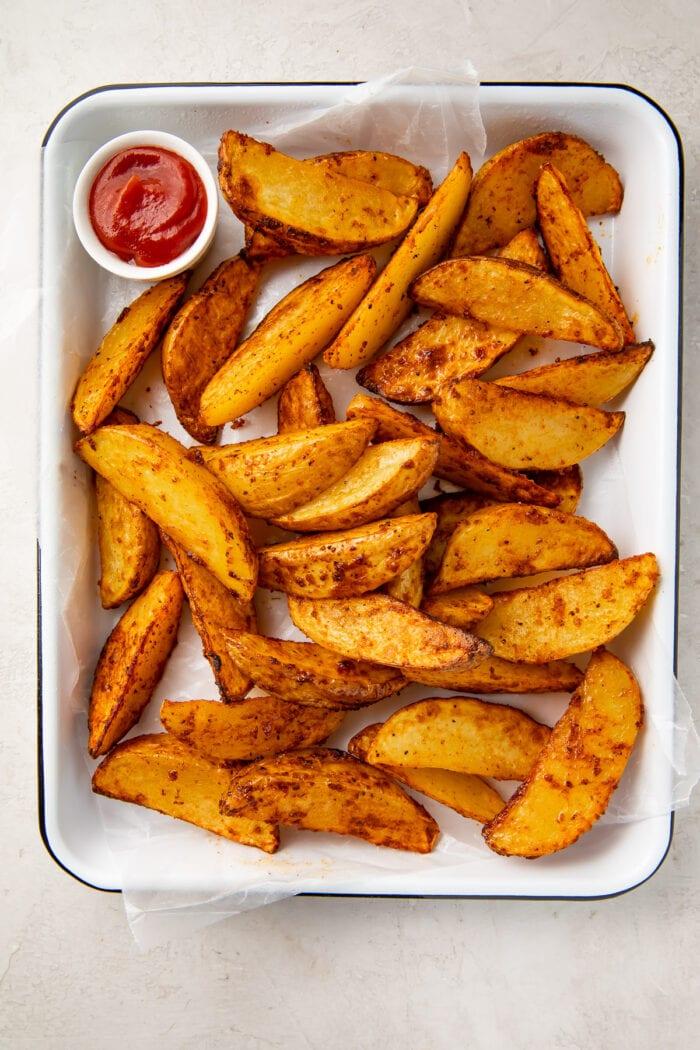 Air fryer potato wedges on a baking sheet