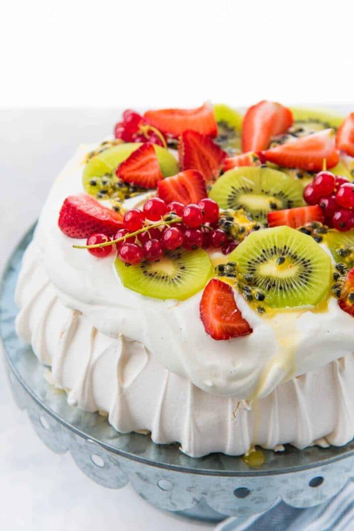 Egg white pavlova topped with strawberry and kiwi
