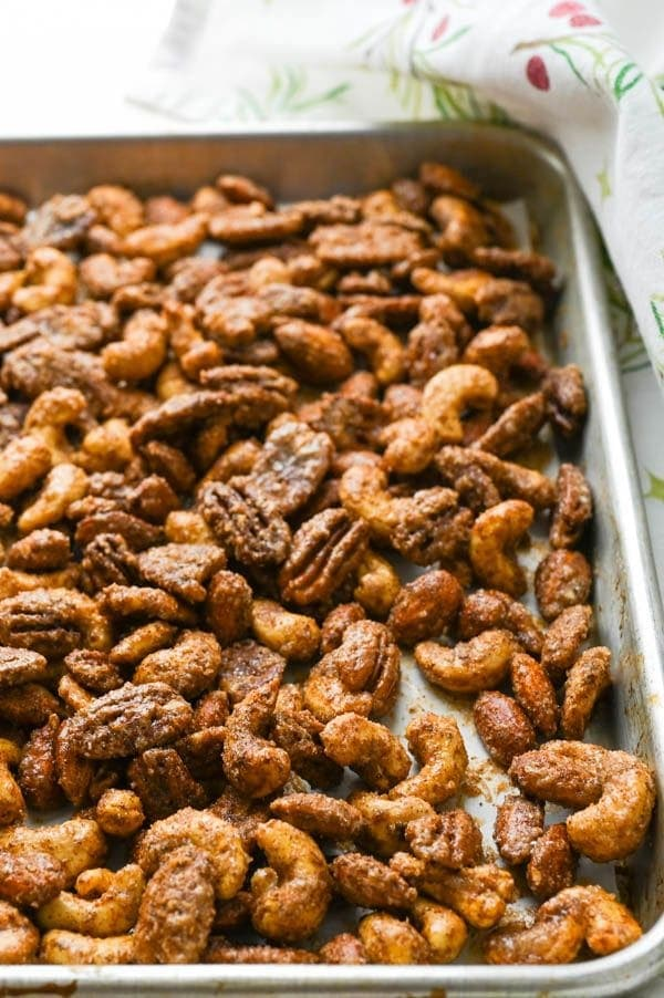 Sweet spicy Christmas nuts on a baking sheet