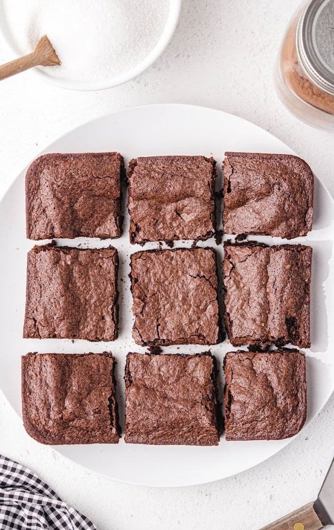 9 egg white brownies on a white plate