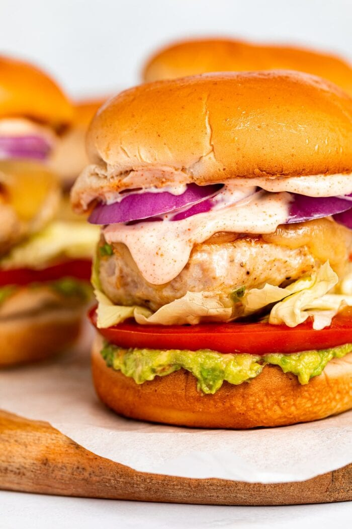 Close-up image of chicken burgers with chipotle aioli.