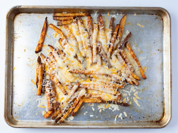 Fries on sheet pan with melted cheese