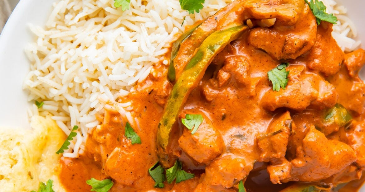 Instant Pot Chicken Tikka Masala in a bowl with basmati rice and naan