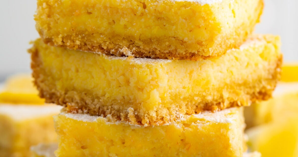 A stack of 4 keto lemon bars against a white background