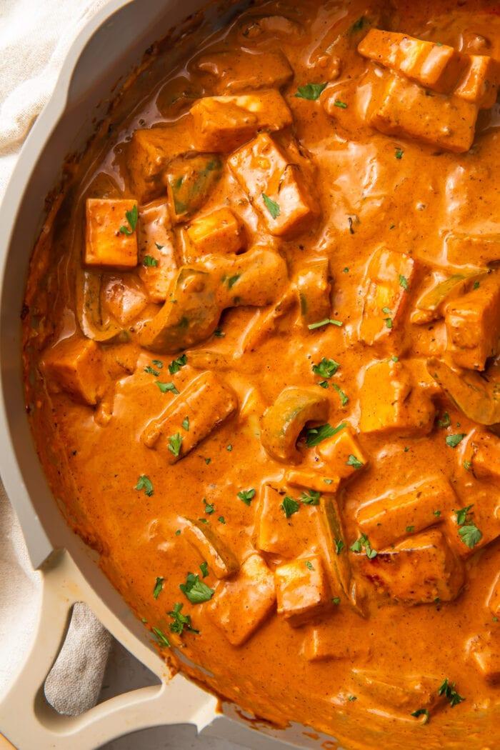 Paneer tikka masala in a large saucepan