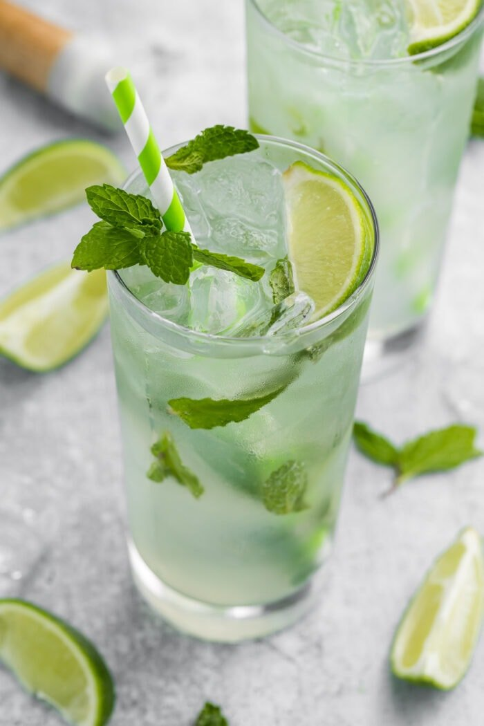 Virgin mojito in a tall glass with a green striped straw