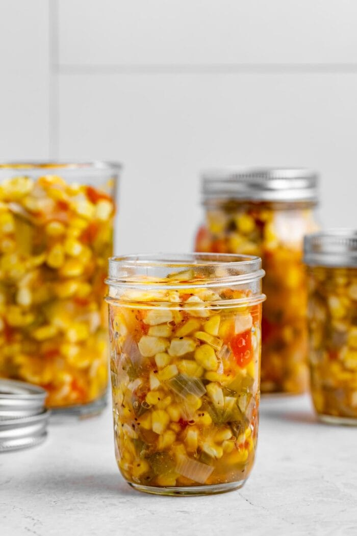 corn relish in four canning jars