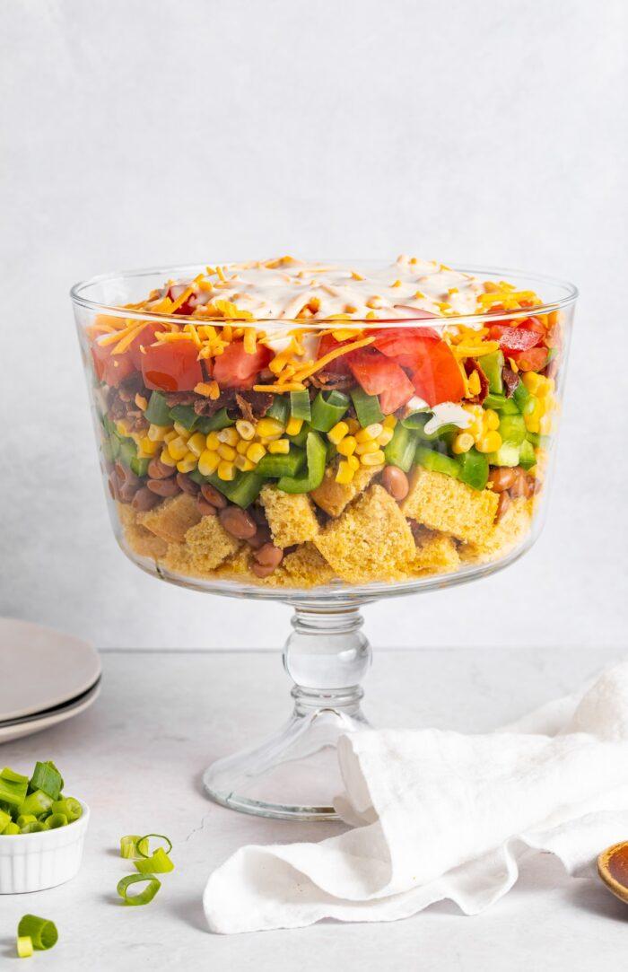 cornbread salad layered in a trifle dish