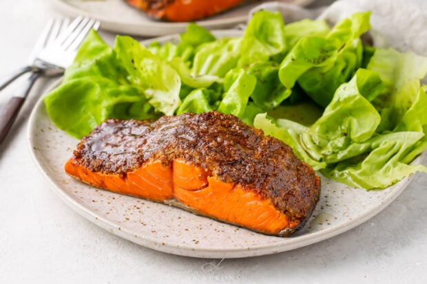 Plated air fryer salmon with a small green salad