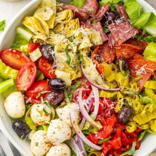 Antipasto salad in a large white bowl, taken from above