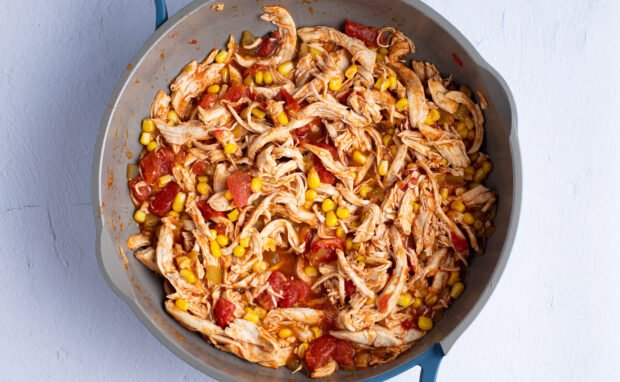 Shredded Mexican chicken in large skillet