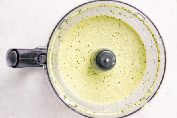 Cilantro-lime dressing in a food processor bowl