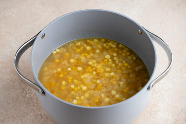 Broth, potatoes, and corn in large pot.