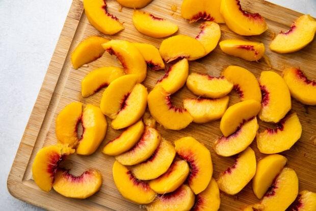 Peach slices on a cutting board