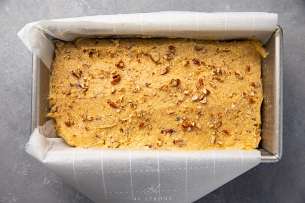 Keto banana bread batter in loaf pan lined with parchment paper