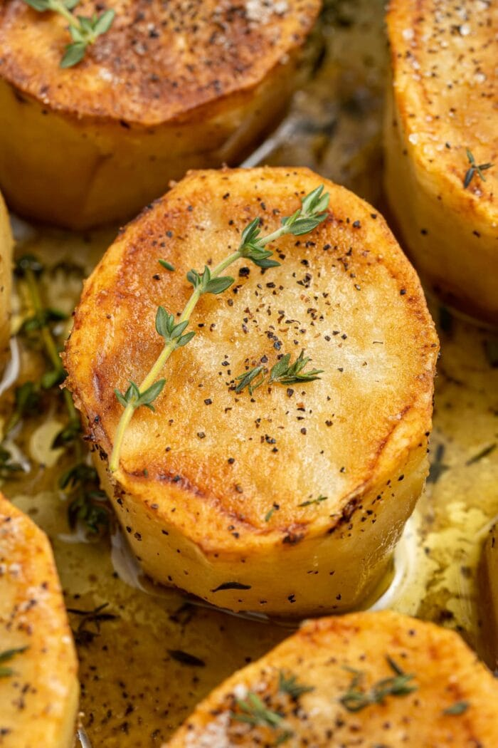 close-up image of fondant potatoes in a skiller