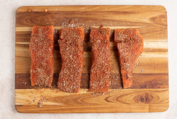Spice rubbed salmon filets on a cutting board