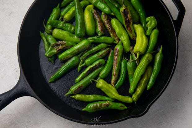 Shishito peppers in large cast iron skillet