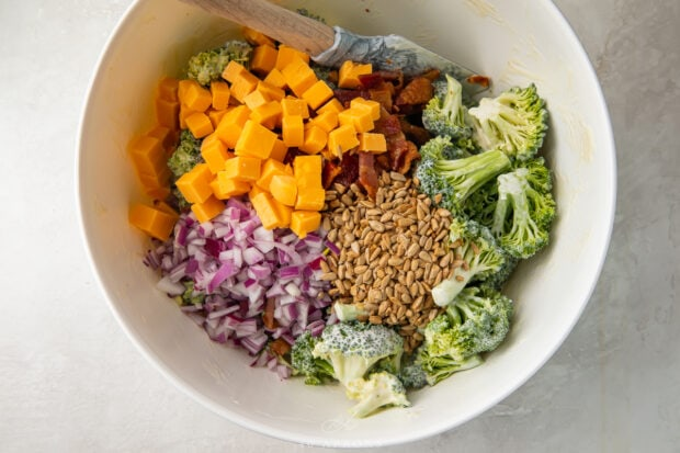 Ingredients for keto broccoli salad in a large bowl