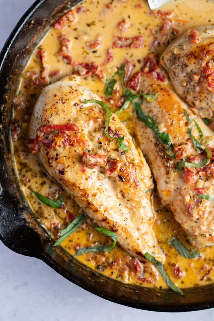 Overhead view of marry me chicken in a cast iron skillet