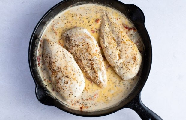 Chicken breasts in marry me sauce in cast iron skillet