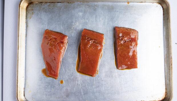 Miso salmon fillets on baking sheet