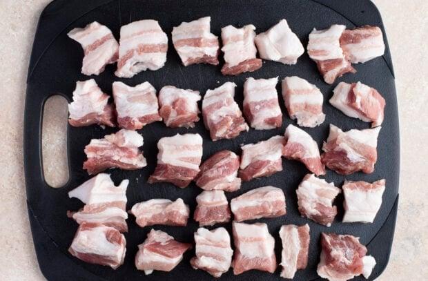 Raw pork belly cut into cubes