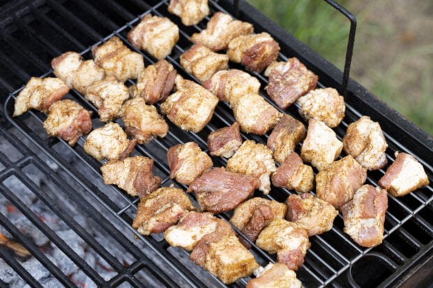 Pork belly cubes on charcoal grill