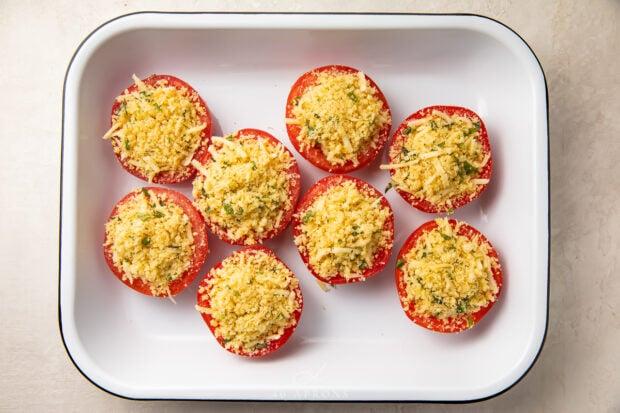 Stuffed tomatoes in baking dish