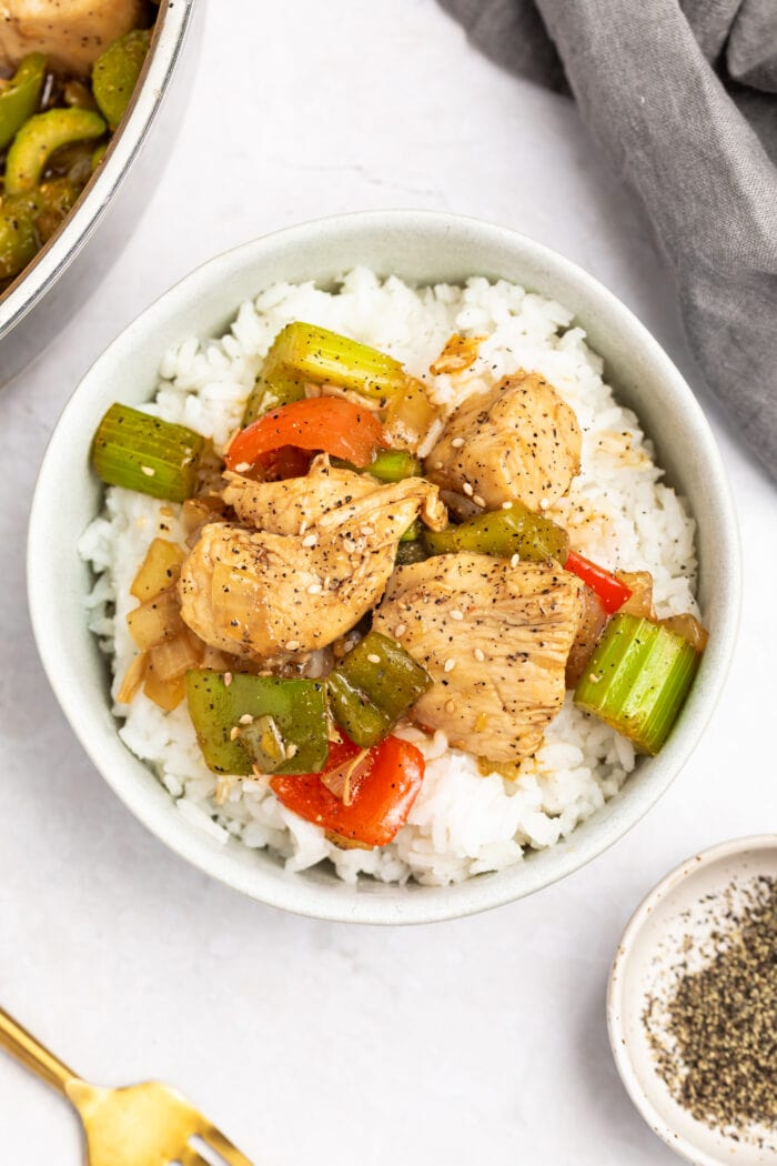 black pepper chicken in a bowl over rice