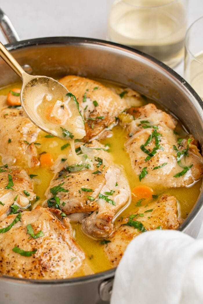 chicken fricassee in a skillet with a spoon