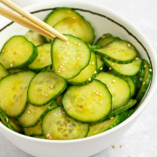 japanese cucumber salad in a bowl with chopsticks