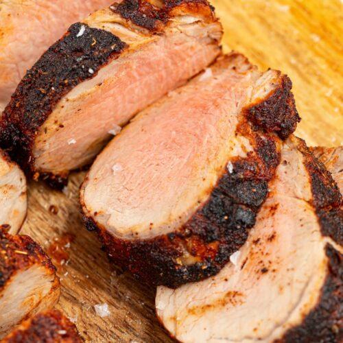 sliced air fryer pork tenderloin on a cutting board