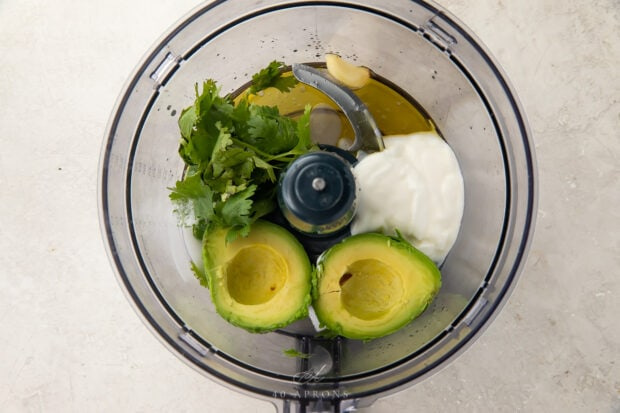 ingredients for avocado dressing in a food processor bowl