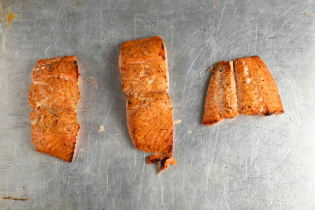 Broiled salmon fillets on baking sheet