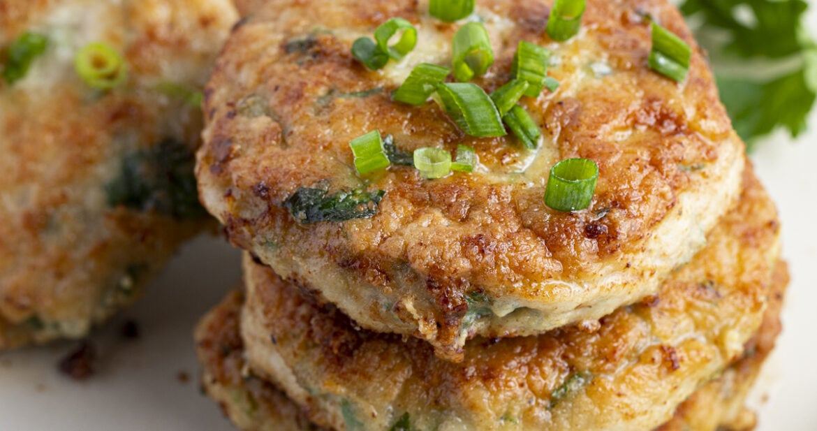 Stack of chicken patties on a white plate