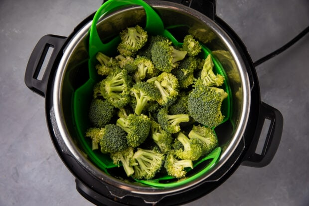 Instant Pot with steamer basket and broccoli florets
