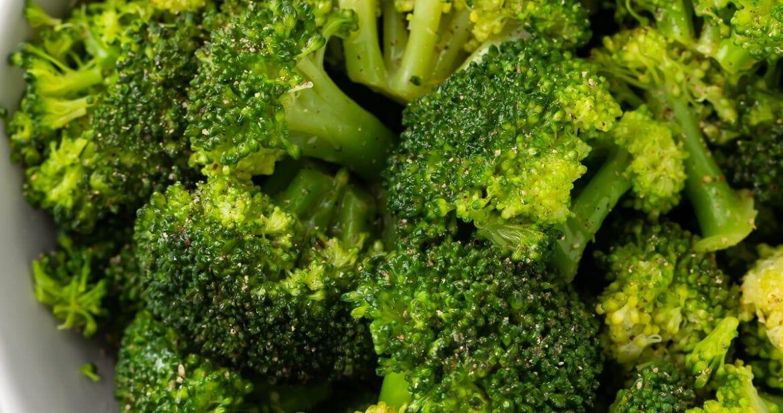 Instant Pot broccoli in a white bowl