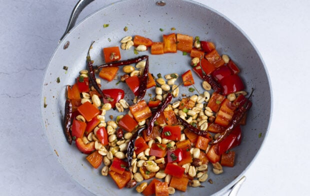 Bell pepper and peanuts in large skillet