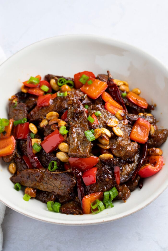Kung pao beef in a white bowl